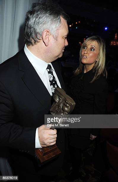 Eamonn Holmes poses with the Digital TV Personality Award presented by Fiona Phillips during the TRIC Awards 2009 at the Grosvenor House Hotel on...