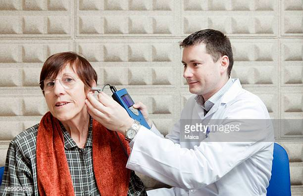 Ear exam on an old lady