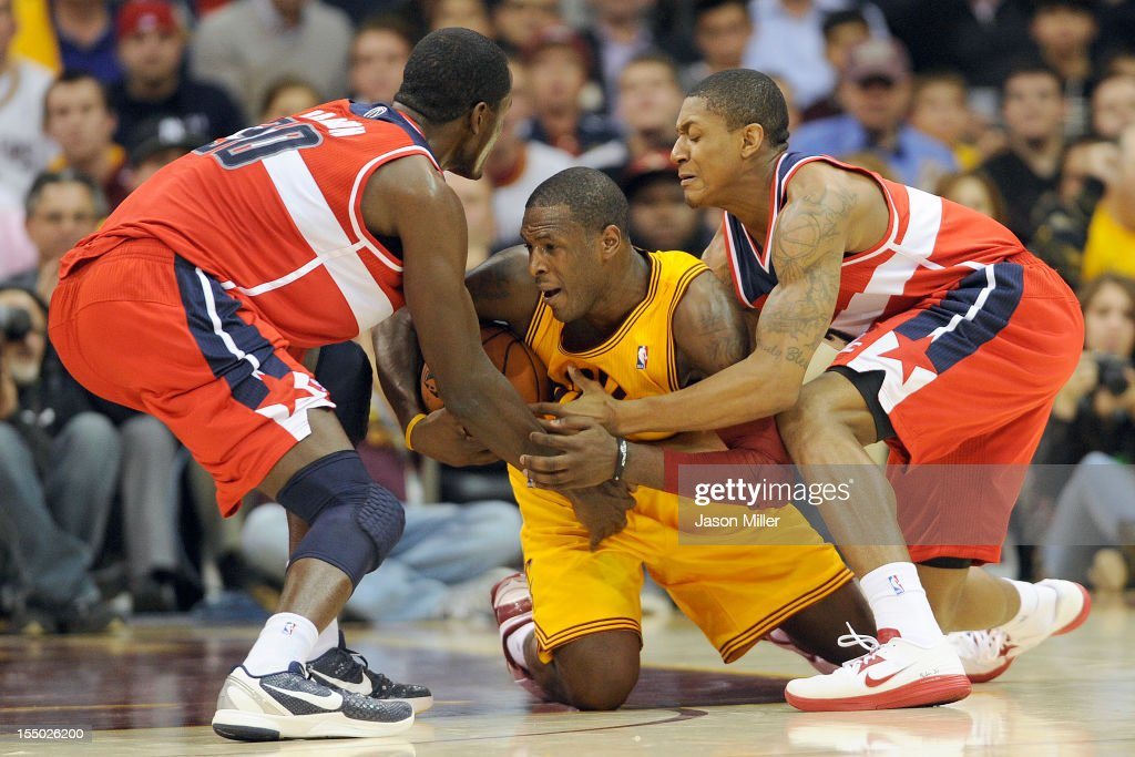 Earl Barron #30 and Bradley Beal #3 of the Washington Wizards struggle for a loose ball with Dion Waiters #3 of the Cleveland Cavaliers during the second half at Quicken Loans Arena on October 30, 2012 in Cleveland, Ohio. The Cavaliers defeated the Wizards 94-84.