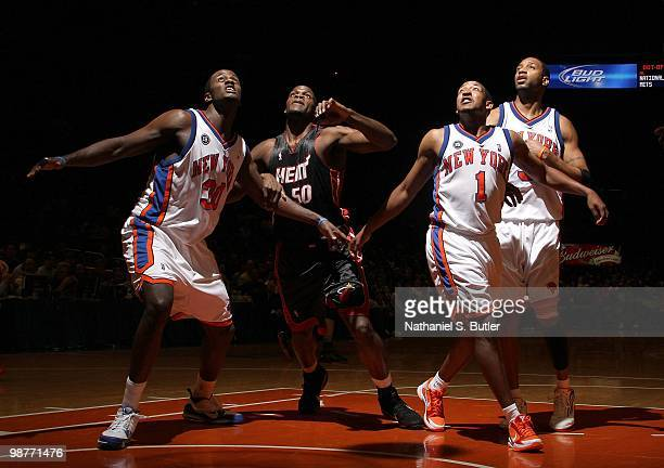 Earl Barron Chris Duhon and Tracy McGrady of the New York Knicks box out as they look to rebound against Joel Anthony of the Miami Heat during the...