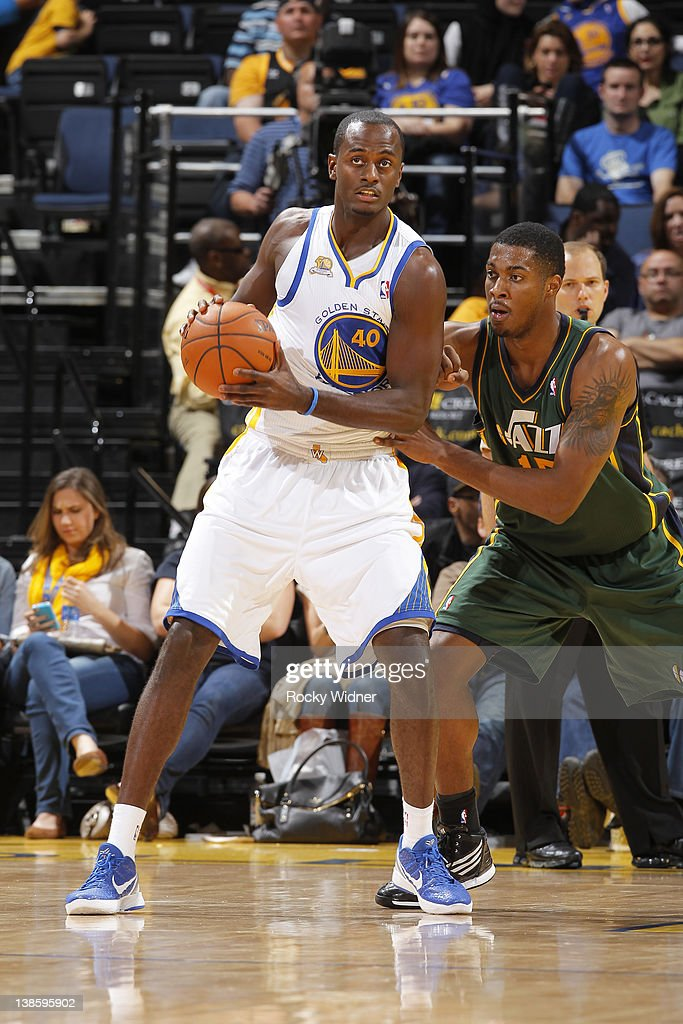 Earl Barron #40 of the Golden State Warriors posts up Derrick Favors #15 of the Utah Jazz on February 2, 2012 at Oracle Arena in Oakland, California.