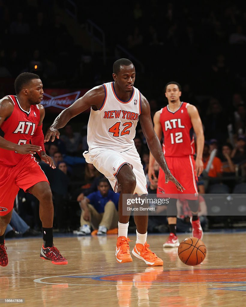 Earl Barron #42 of the New York Knicks dribbles the ball against the Atlanta Hawks at Madison Square Garden on April 17, 2013 in New York City. The Knicks defeated the Hawks 98-92.