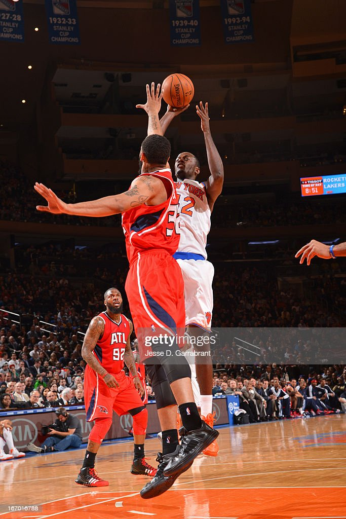 Earl Barron #42 of the New York Knicks shoots the ball against Mike Scott #32 of the Atlanta Hawks on April 17, 2013 at Madison Square Garden in New York City, New York.