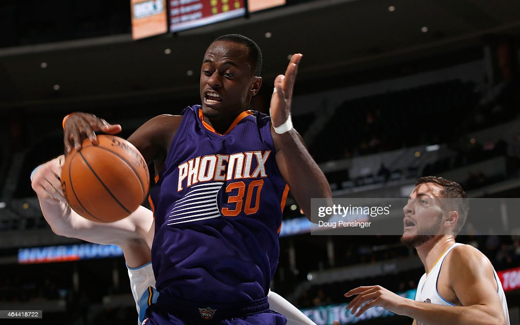 <a gi-track='captionPersonalityLinkClicked' href=/galleries/search?phrase=Earl+Barron&family=editorial&specificpeople=234747 ng-click='$event.stopPropagation()'>Earl Barron</a> #30 of the Phoenix Suns collects a rebound against <a gi-track='captionPersonalityLinkClicked' href=/galleries/search?phrase=Joffrey+Lauvergne&family=editorial&specificpeople=6828069 ng-click='$event.stopPropagation()'>Joffrey Lauvergne</a> #77 of the Denver Nuggets at Pepsi Center on February 25, 2015 in Denver, Colorado.
