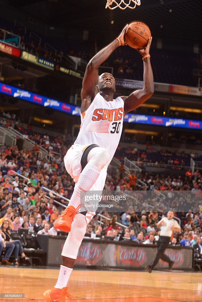 <a gi-track='captionPersonalityLinkClicked' href=/galleries/search?phrase=Earl+Barron&family=editorial&specificpeople=234747 ng-click='$event.stopPropagation()'>Earl Barron</a> #30 of the Phoenix Suns drives for a shot against the Denver Nuggets during a preseason game on October 10, 2014 at U.S. Airways Center in Phoenix, Arizona.
