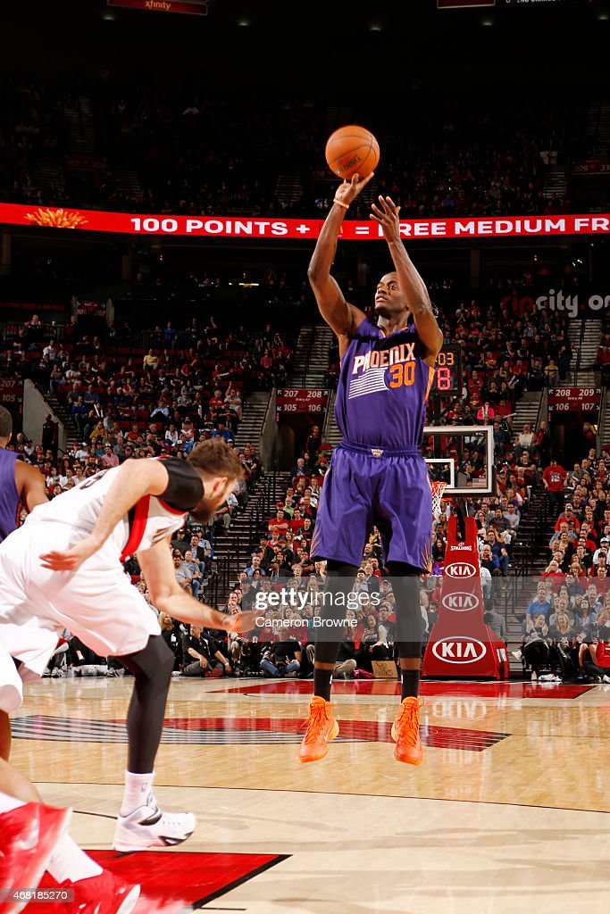 <a gi-track='captionPersonalityLinkClicked' href=/galleries/search?phrase=Earl+Barron&family=editorial&specificpeople=234747 ng-click='$event.stopPropagation()'>Earl Barron</a> #30 of the Phoenix Suns shoots against the Portland Trail Blazers during the game on March 30, 2015 at Moda Center in Portland, Oregon.