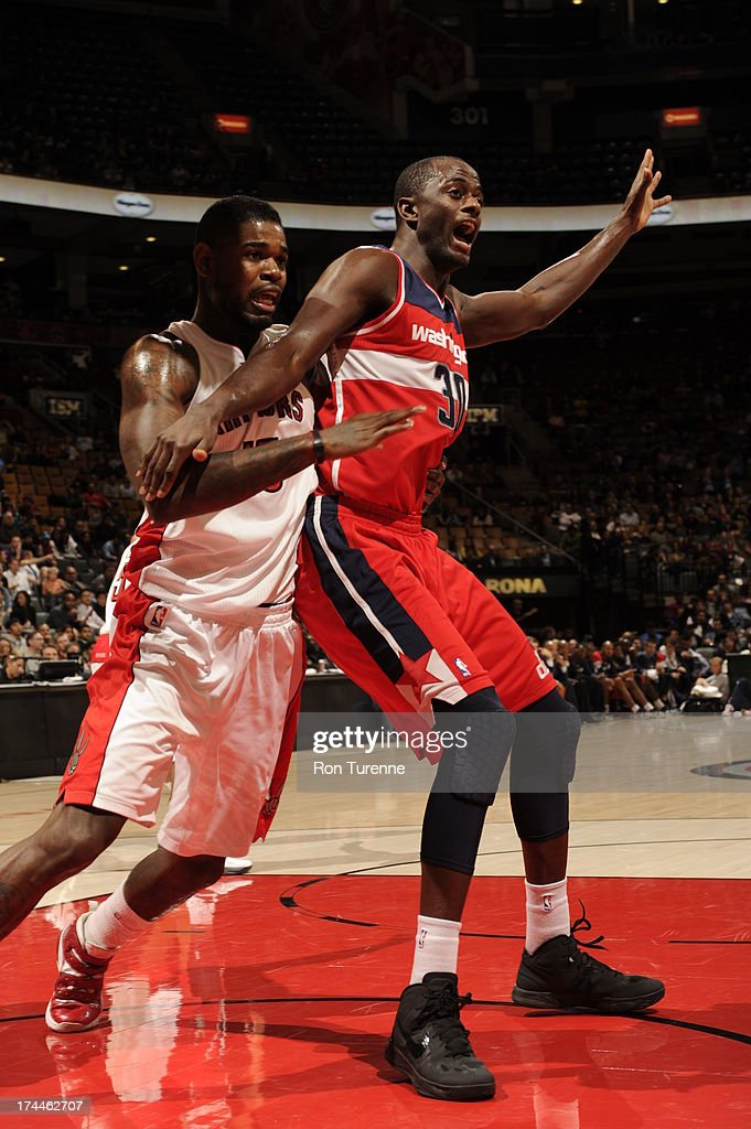 Earl Barron #30 of the Washington Wizards posts-up against Amir Johnson #15 of the Toronto Raptors during a pre-season game on October 17, 2012 at the Air Canada Centre in Toronto, Ontario, Canada.