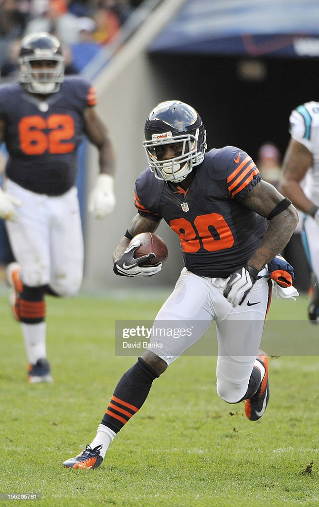 Earl Bennett #80 of the Chicago Bears runs after making a catch against the Carolina Panthers on October 28, 2012 at Soldier Field in Chicago, Illinois.