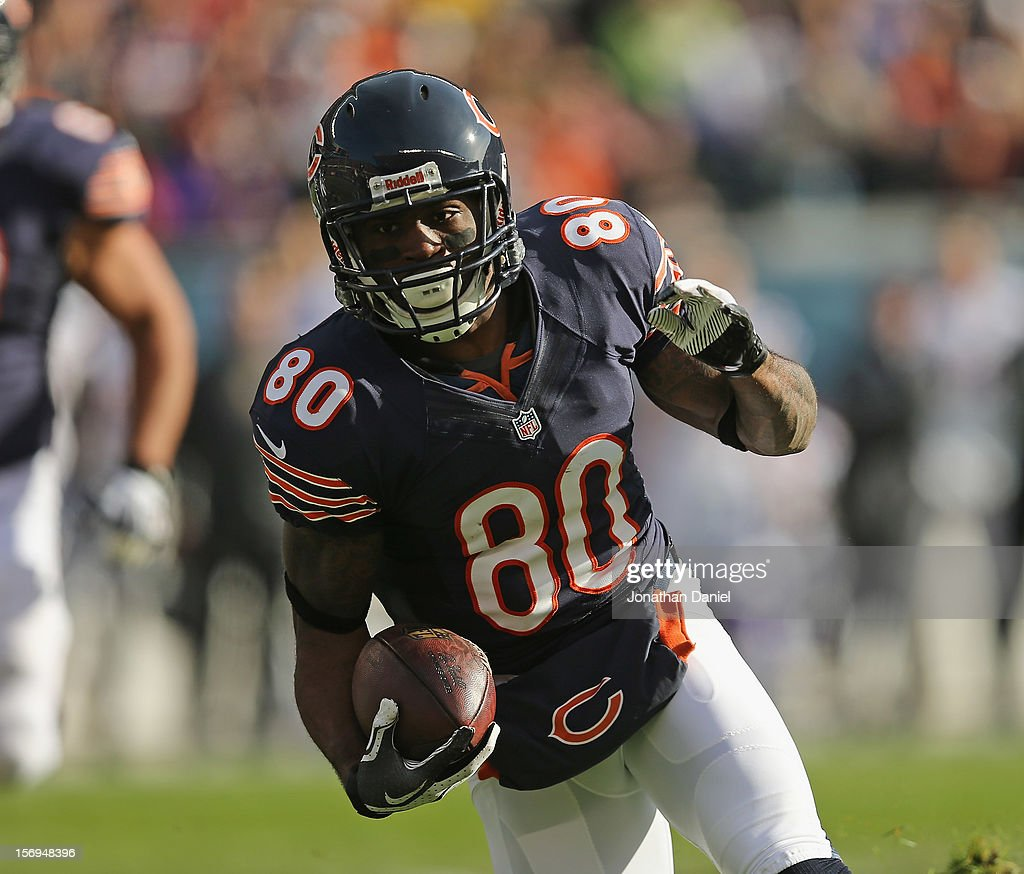 Earl Bennett #80 of the Chicago Bears runs for a first down after a catch against the Minnesota Vikings at Soldier Field on November 25, 2012 in Chicago, Illinois. The Bears defeated the Vikings 28-10.