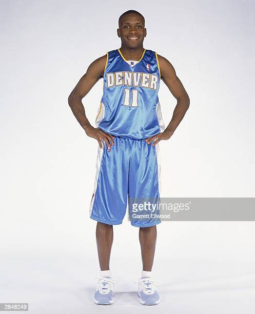 Earl Boykins of the Denver Nuggets poses for a portrait on December 20 2003 in Denver Colorado NOTE TO USER User expressly acknowledges and agrees...