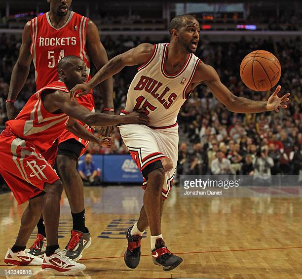 Earl Boykins of the Houston Rockets grabs John Lucas III of the Chicago Bulls at the United Center on April 2 2012 in Chicago Illinois The Rockets...