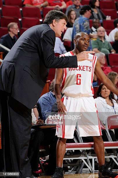 Earl Boykins of the Houston Rockets speaks to Head Coach Kevin McHale of the Houston Rockets during the game between the Houston Rockets and the...
