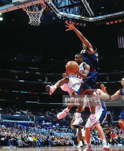 Earl Boykins of the Los Angeles Clippers passes the ball against Nick Van Exel of the Denver Nuggets on January 10 2001 at Staples Center in Los...