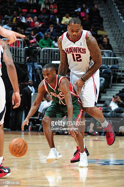 Earl Boykins of the Milwakee Bucks moves the ball against the Atlanta Hawks on March 15 2011 at Philips Arena in Atlanta Georgia NOTE TO USER User...