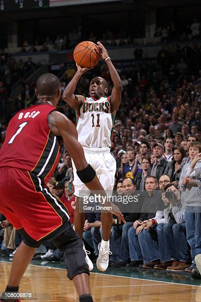 Earl Boykins of the Milwakee Bucks shoots the ball against the Miami Heat on January 7 2011 at the Bradley Center in Milwaukee Wisconsin NOTE TO USER...