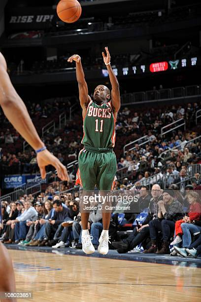 Earl Boykins of the Milwakee Bucks shoots the ball against the New Jersey Nets on January 8 2011 at the Prudential Center in Newark New Jersey NOTE...