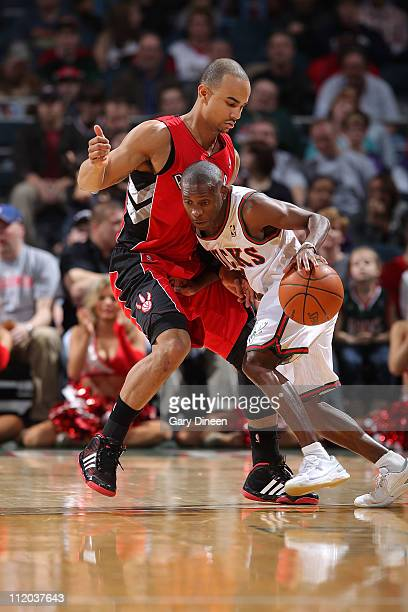 Earl Boykins of the Milwaukee Bucks dribbles against Jerryd Bayless of the Toronto Raptors during the NBA game on April 11 2011 at the Bradley Center...