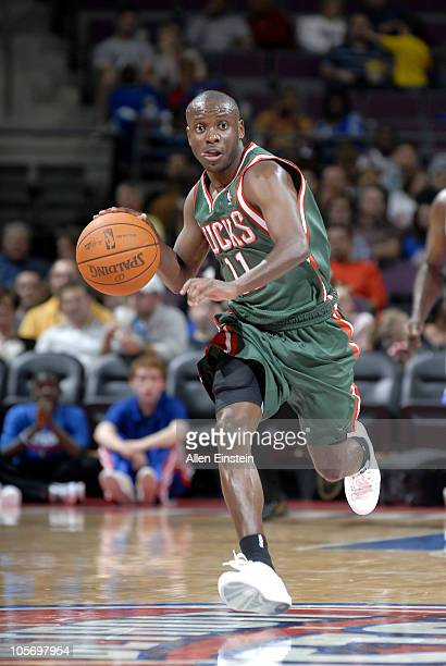 Earl Boykins of the Milwaukee Bucks drives the ball against the Detroit Pistons on October 8 2010 at the Palace of Auburn Hills in Auburn Hills...