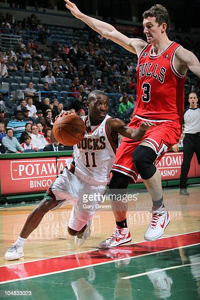 Earl Boykins of the Milwaukee Bucks drives to the basket against Omer Asik of the Chicago Bulls during the NBA Preseason game on October 5 2010 at...