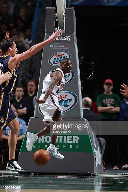 Earl Boykins of the Milwaukee Bucks passes against Jeff Foster of the Indiana Pacers during the NBA game on February 12 2011 at the Bradley Center in...