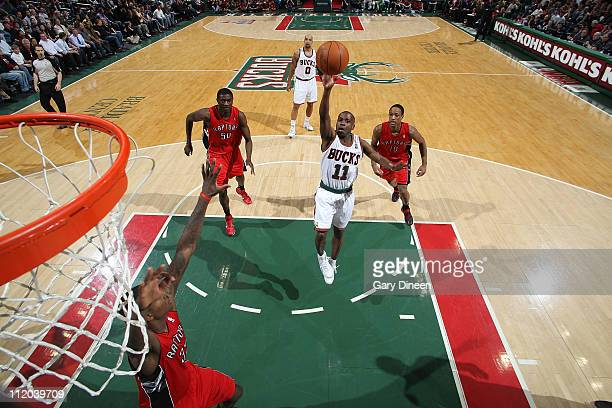 Earl Boykins of the Milwaukee Bucks shoots a floater against Ed Davis of the Toronto Raptors during the NBA game on April 11 2011 at the Bradley...