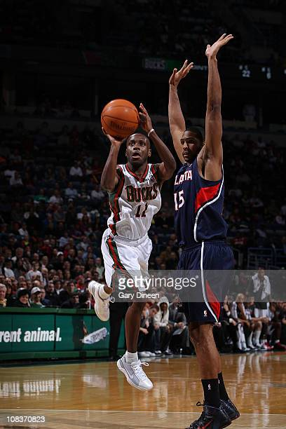 Earl Boykins of the Milwaukee Bucks shoots a jumpshot against Al Horford of the Atlanta Hawks during the NBA game on January 26 2011 at the Bradley...
