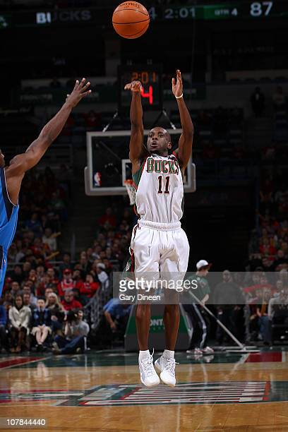 Earl Boykins of the Milwaukee Bucks shoots a jumpshot against the Dallas Mavericks during the NBA game on January 1 2011 at the Bradley Center in...