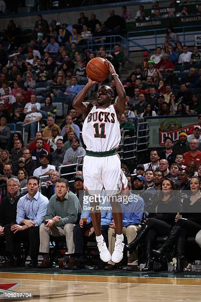 Earl Boykins of the Milwaukee Bucks shoots a jumpshot to tie the game at 71 all against the Denver Nuggets during the NBA game on February 16 2011 at...