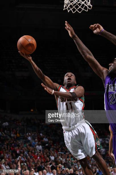 Earl Boykins of the Milwaukee Bucks shoots a layup against Donte Greene of the Sacramento Kings during the NBA game on March 23 2011 at the Bradley...