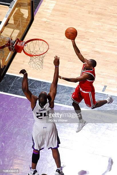 Earl Boykins of the Milwaukee Bucks shoots against Carl Landry of the Sacramento Kings on December 23 2010 at ARCO Arena in Sacramento California...
