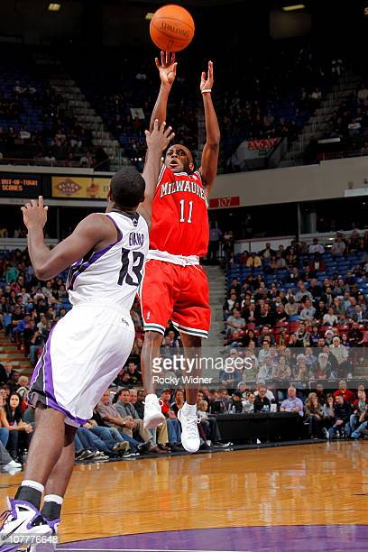 Earl Boykins of the Milwaukee Bucks shoots the ball over Tyreke Evans of the Sacramento Kings on December 23 2010 at ARCO Arena in Sacramento...