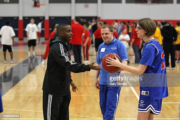 Earl Boykins of the Milwaukee Bucks works with participants during the Special Olympics Basketball Clinic on February 7 2011 at Homestead High School...