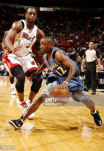 Earl Boykins of the Washington Wizards makes a move to the basket against Dwyane Wade of the Miami Heat during the game at American Airlines Arena on...