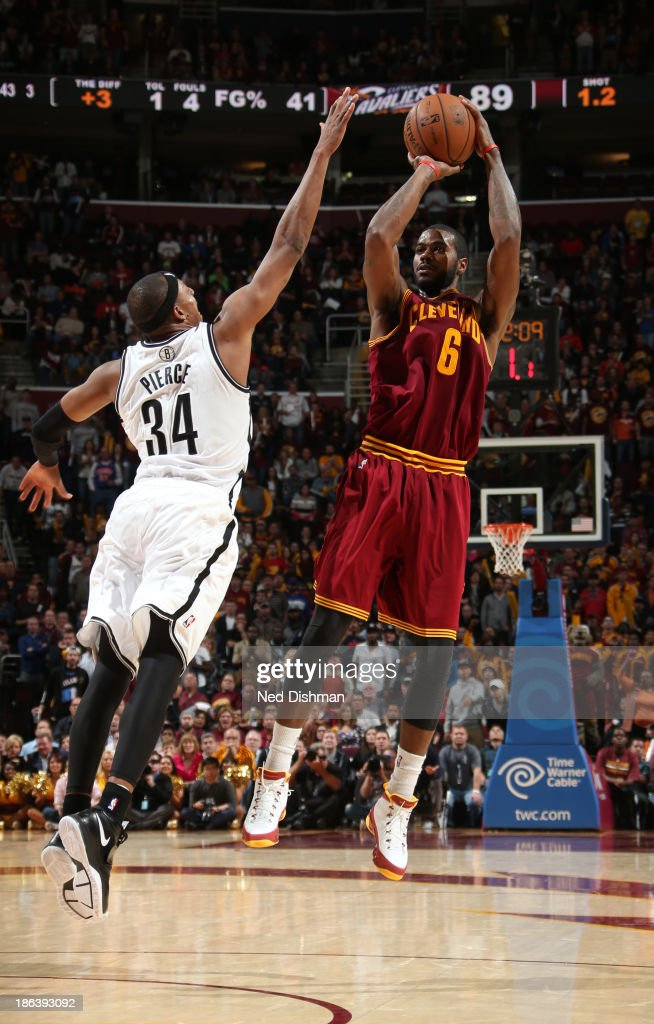 Earl Clark #6 of the Cleveland Cavaliers shoots against <a gi-track='captionPersonalityLinkClicked' href=/galleries/search?phrase=Paul+Pierce&family=editorial&specificpeople=201562 ng-click='$event.stopPropagation()'>Paul Pierce</a> #34 of the Brooklyn Nets during a game at the Quicken Loans Arena on October 30, 2013 in Cleveland, Ohio.