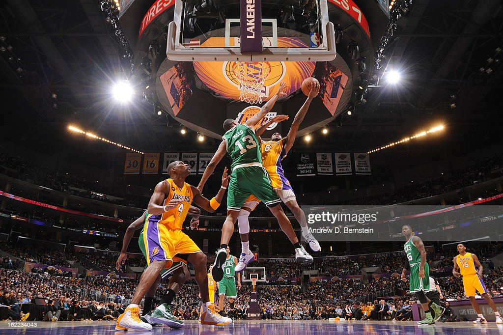Earl Clark #6 of the Los Angeles Lakers attempts a layup against Fab Melo #13 of the Boston Celtics during a game at Staples Center on February 20, 2013 in Los Angeles, California.