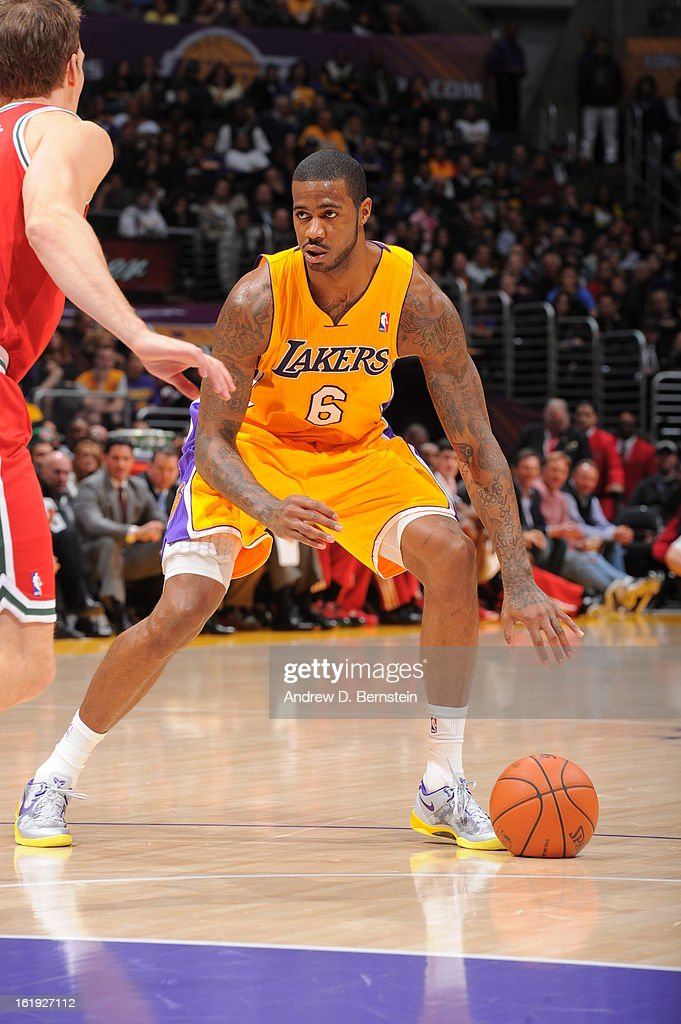 Earl Clark #6 of the Los Angeles Lakers dribbles the ball while looking to pass against the Milwaukee Bucks at Staples Center on January 15, 2013 in Los Angeles, California.