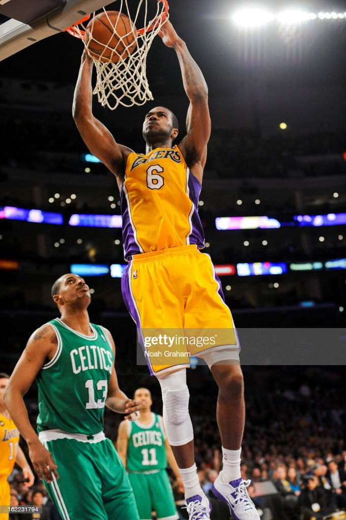 Earl Clark #6 of the Los Angeles Lakers dunks against Fab Melo #13 of the Boston Celtics at Staples Center on February 20, 2013 in Los Angeles, California.