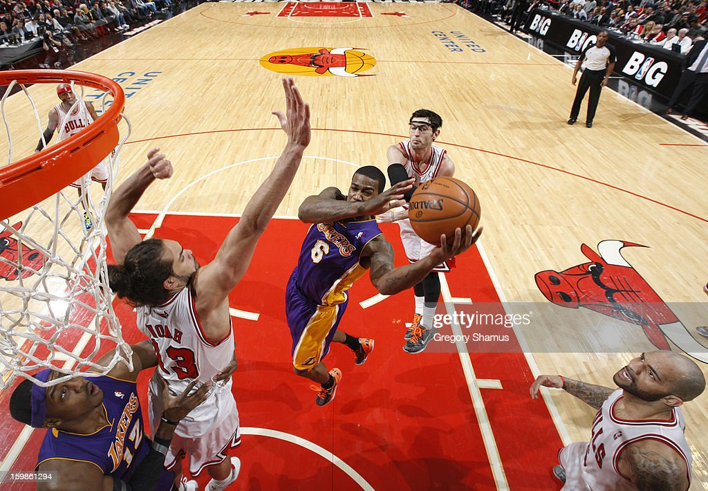 Earl Clark #6 of the Los Angeles Lakers goes to the basket against Joakim Noah #13 of the Chicago Bulls on January 21, 2013 at the United Center in Chicago, Illinois.