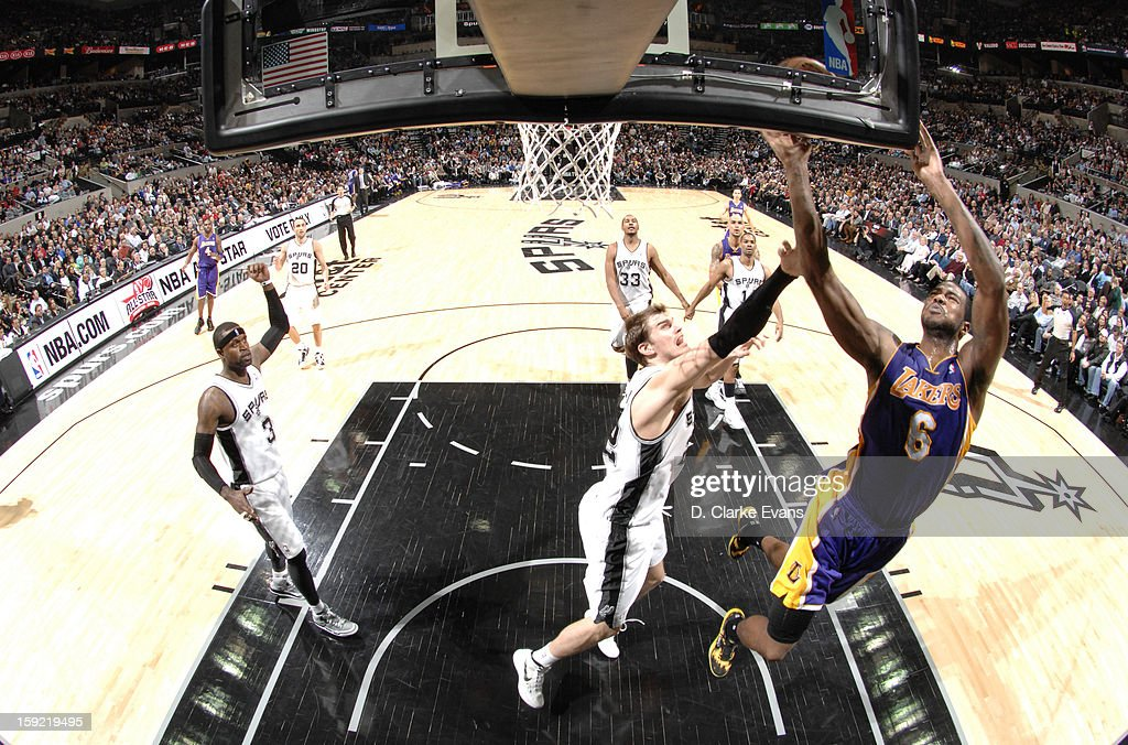 Earl Clark #6 of the Los Angeles Lakers goes to the basket against <a gi-track='captionPersonalityLinkClicked' href=/galleries/search?phrase=Tiago+Splitter&family=editorial&specificpeople=208218 ng-click='$event.stopPropagation()'>Tiago Splitter</a> #22 of the San Antonio Spurs during the game between the Los Angeles Lakers and the San Antonio Spurs on January 9, 2013 at the AT&T Center in San Antonio, Texas.