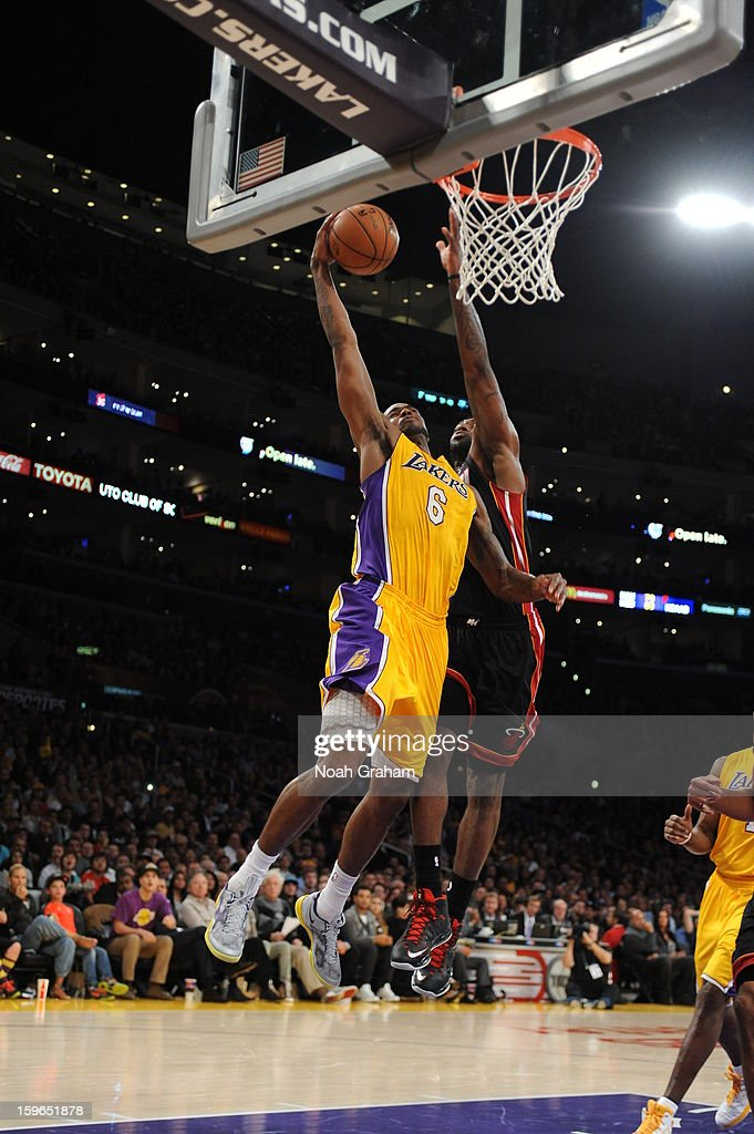 Earl Clark #6 of the Los Angeles Lakers has his shot blocked by LeBron James #6 of the Miami Heat at Staples Center on January 15, 2013 in Los Angeles, California.