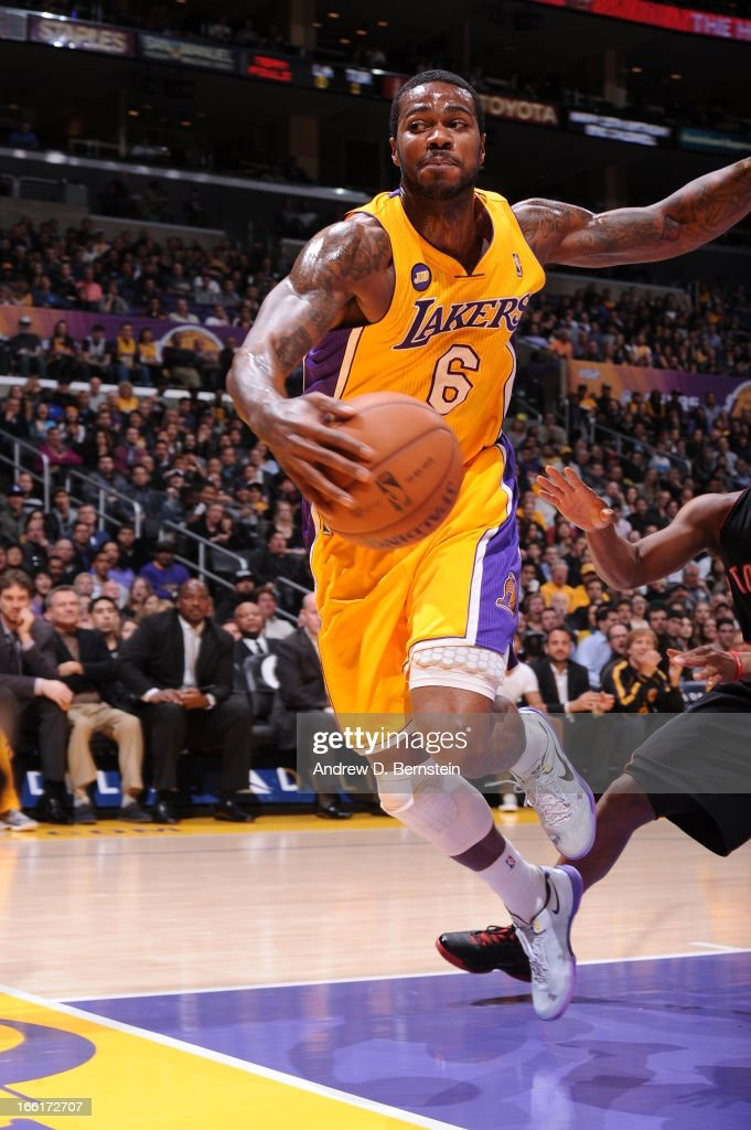 Earl Clark #6 of the Los Angeles Lakers hustles for the ball against the Toronto Raptors at Staples Center on March 8, 2013 in Los Angeles, California.