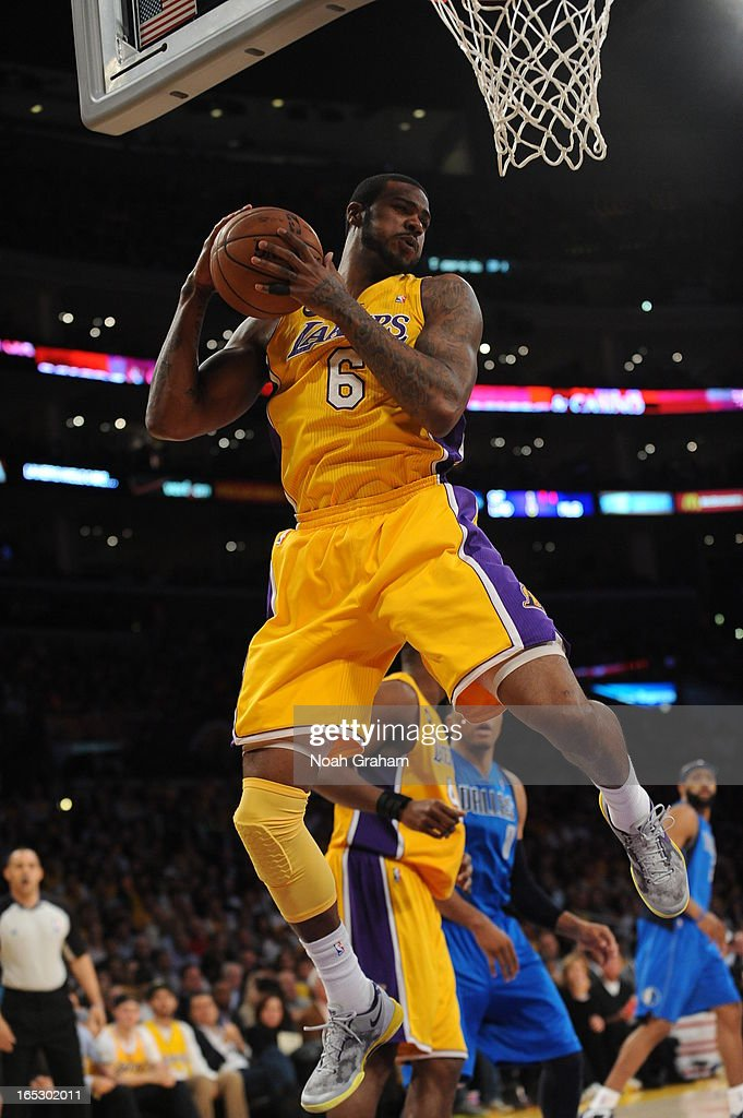 Earl Clark #6 of the Los Angeles Lakers pulls down a rebound against the Dallas Mavericks at Staples Center on April 2, 2013 in Los Angeles, California.