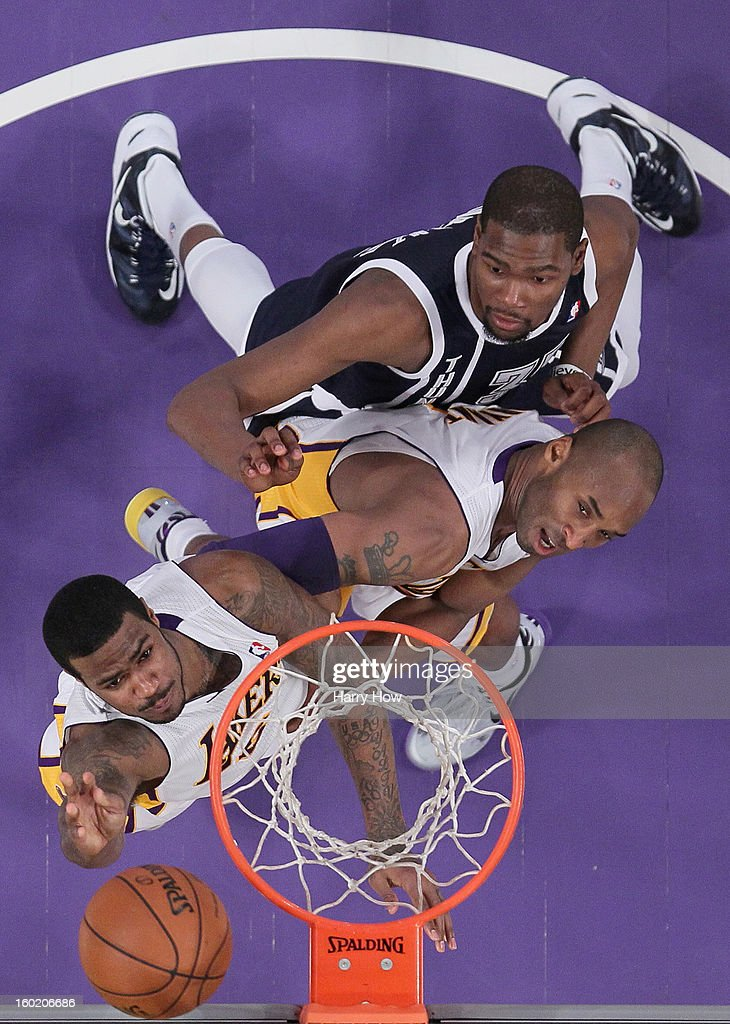 Earl Clark #6 of the Los Angeles Lakers scores in front of <a gi-track='captionPersonalityLinkClicked' href=/galleries/search?phrase=Kobe+Bryant&family=editorial&specificpeople=201466 ng-click='$event.stopPropagation()'>Kobe Bryant</a> #24 and <a gi-track='captionPersonalityLinkClicked' href=/galleries/search?phrase=Kevin+Durant&family=editorial&specificpeople=3847329 ng-click='$event.stopPropagation()'>Kevin Durant</a> #35 of the Oklahoma City Thunder during a 106-95 Laker win at Staples Center on January 27, 2013 in Los Angeles, California.