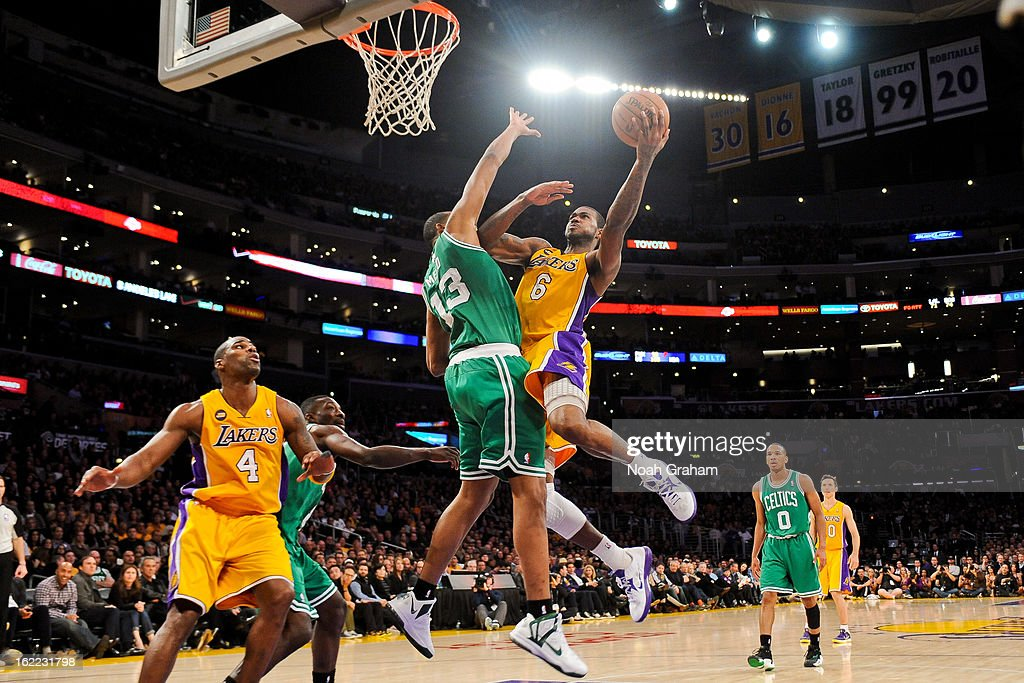 Earl Clark #6 of the Los Angeles Lakers shoots a layup against Fab Melo #13 of the Boston Celtics at Staples Center on February 20, 2013 in Los Angeles, California.