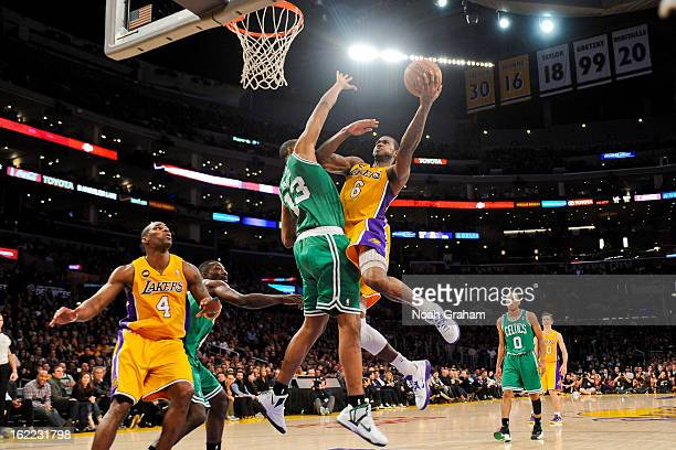 Earl Clark of the Los Angeles Lakers shoots a layup against Fab Melo of the Boston Celtics at Staples Center on February 20 2013 in Los Angeles...