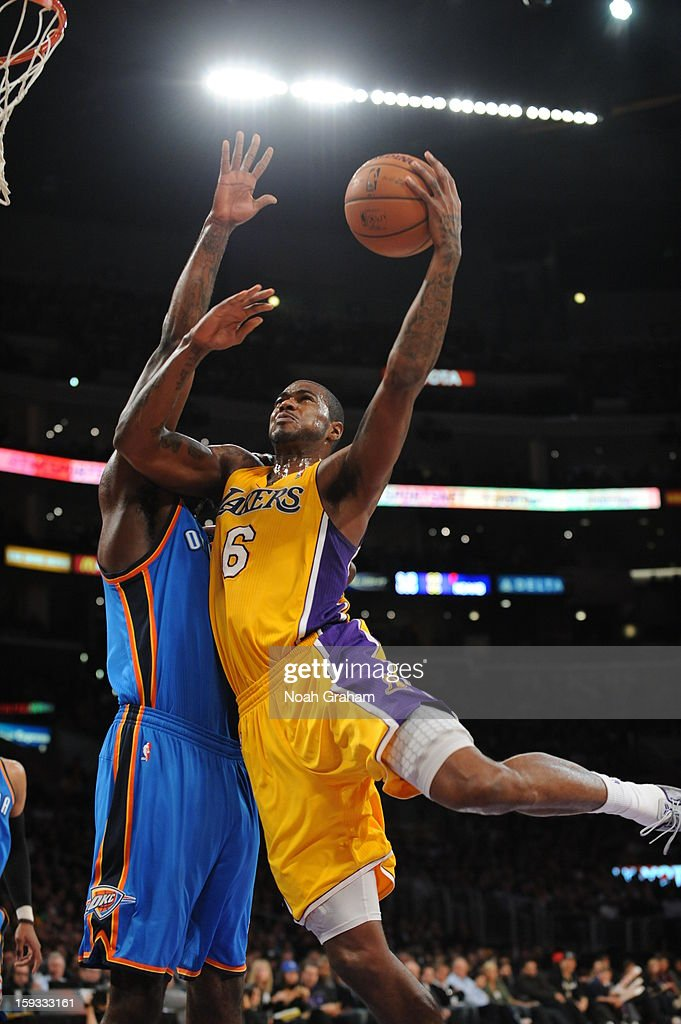 Earl Clark #6 of the Los Angeles Lakers shoots against the Oklahoma City Thunder at Staples Center on January 11, 2013 in Los Angeles, California.