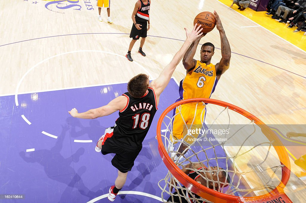 Earl Clark #6 of the Los Angeles Lakers shoots in the lane against <a gi-track='captionPersonalityLinkClicked' href=/galleries/search?phrase=Victor+Claver&family=editorial&specificpeople=5562510 ng-click='$event.stopPropagation()'>Victor Claver</a> #18 of the Portland Trail Blazers at Staples Center on February 22, 2013 in Los Angeles, California.