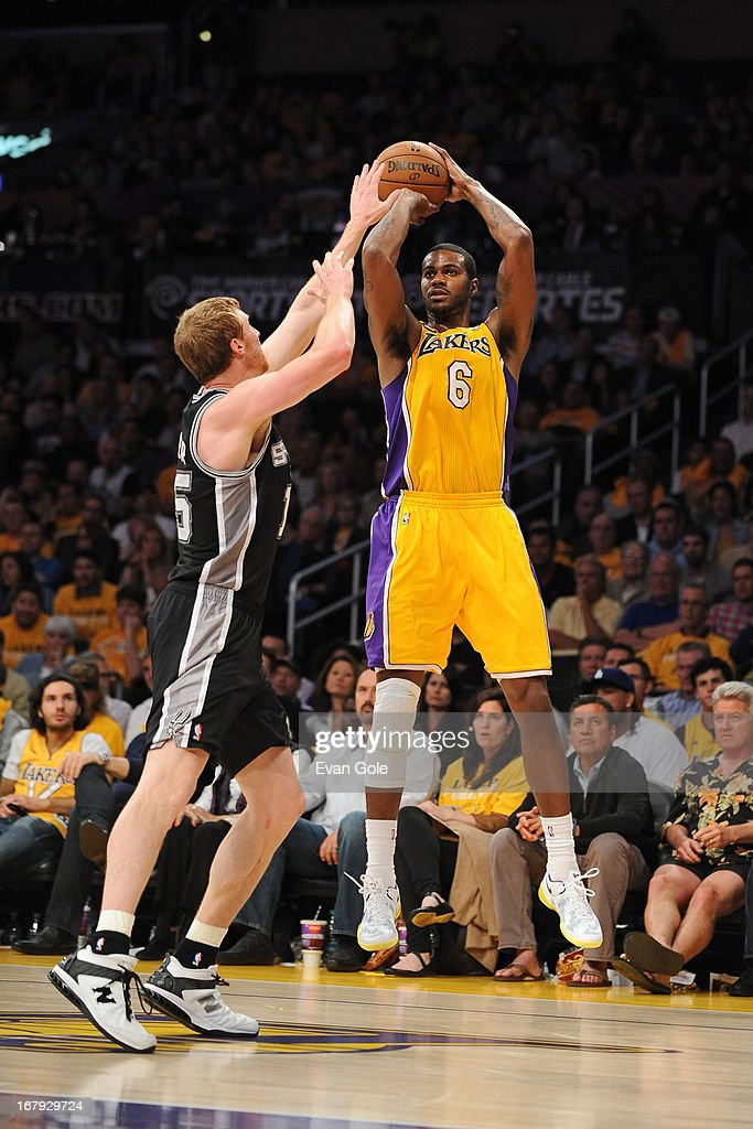 Earl Clark #6 of the Los Angeles Lakers shoots the ball against the San Antonio Spurs at Staples Center in Game Three of the Western Conference Quarterfinals during the 2013 NBA Playoffs on April 26, 2013 in Los Angeles, California.