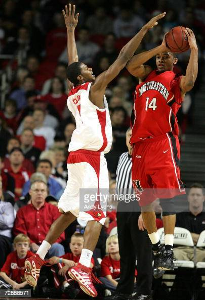 Earl Clark of the Louisville Cardinals defends Bennet Davis of the Northeastern Huskies on December 27 2006 at Freedom Hall in Louisville Kentucky
