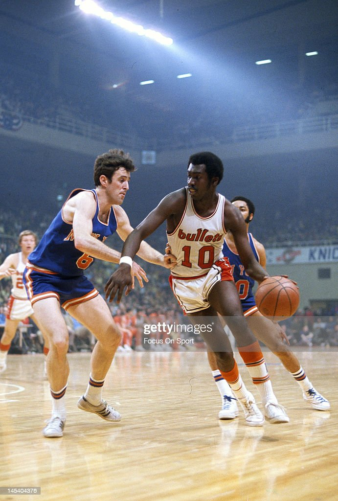 Earl Monroe of the Baltimore Bullets drives on Mike Riordan of the New York Knicks during an NBA basketball game circa 1970 at the Baltimore Coliseum...
